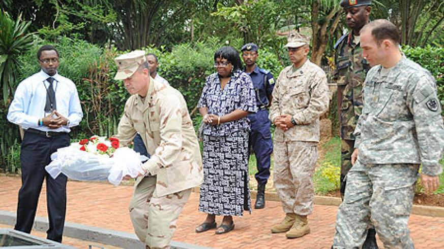 Rear Admiral Brian L. Losey paying tribute to genocide victims at Kigali Genocide Memorial centre yesterday (Photo; J. Mbanda)