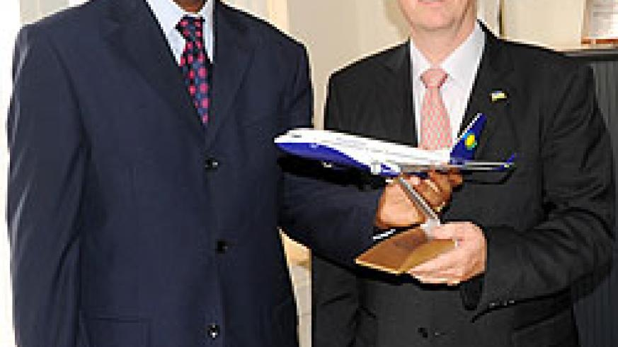 John Mirenge (L) and the outgoing CEO of RwandAir, Rene Janata early this year (File Photo)