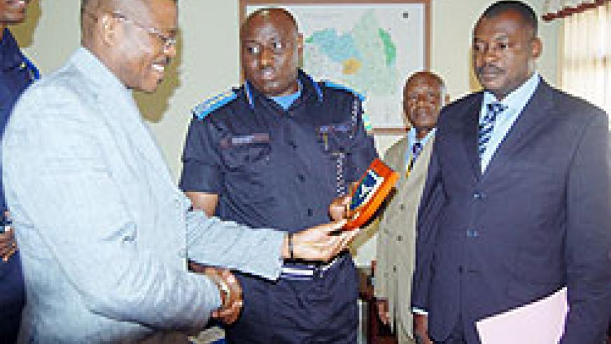 The Commissioner General of Police, Emmanuel Gasana, with some of the visiting delegates at Police headquaters yesterday. (courtesy photo)