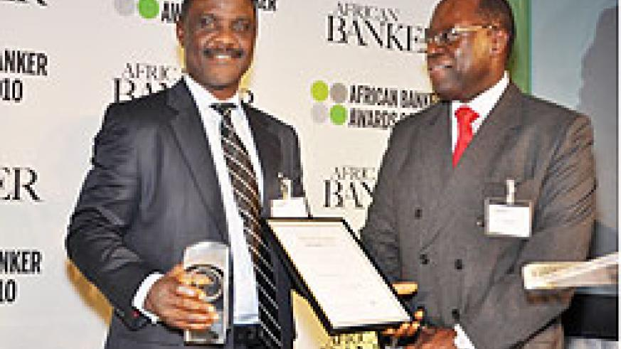 Joel Kibaso presenting the award for Socially Responsible Bank of the Year to Tek Koroye, Executive Director, Operations, Access Bank Plc