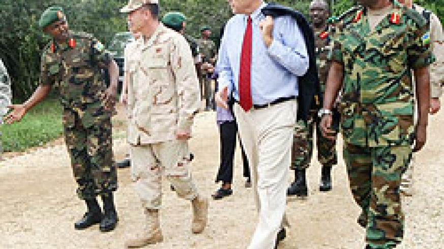 Col. Aloys Muganga talking to Admiral Brian L. Losey as Amb. Stuart Symington and Brig. Gen. Jean Bosco Kazura look on (Courtesy photo)