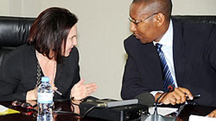 Minister of Finance John Rwangombwa (R) talks to the Head of DFID in Rwanda Elizabeth Carriere at the press conference recently (File photo)