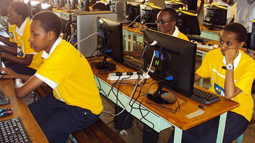 Students of St. Bernadette using the computers donated by the MTN Foundation (Photo; P. Ntambara)
