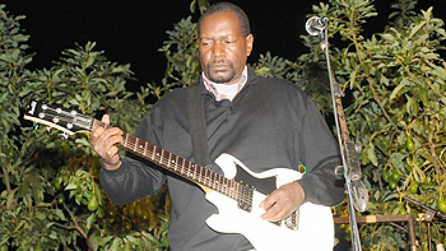 A Kenyan guitarist performs before police stopped the show.