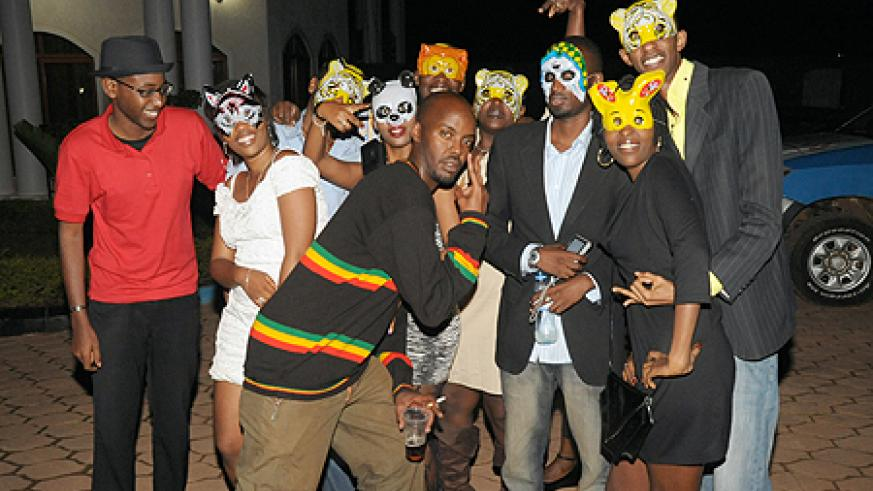 Party starters Halloween fans pull out a strike with their masks.