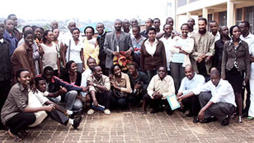 Some of the trainees and their trainers pose for a group photo (Photo G. Mugoya)
