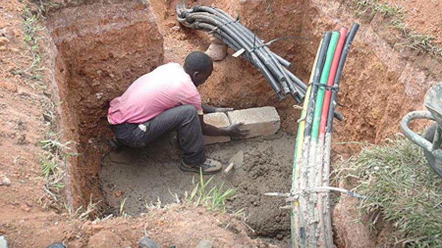 A man connects Optic Fibre Internet cables in Kigali. (File Photo)