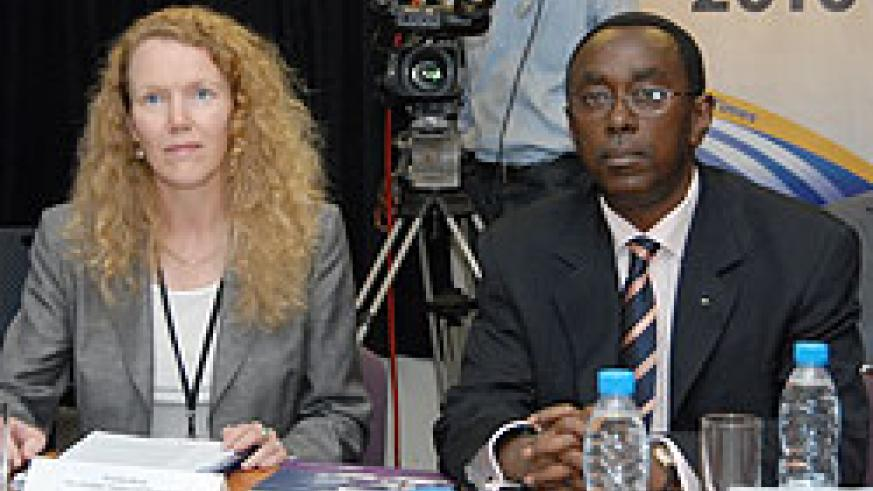 Premier Bernard Makuza and WB's Penelope Brook  during the presentation of the World Bank's 2010 Doing Business Report (File photo)