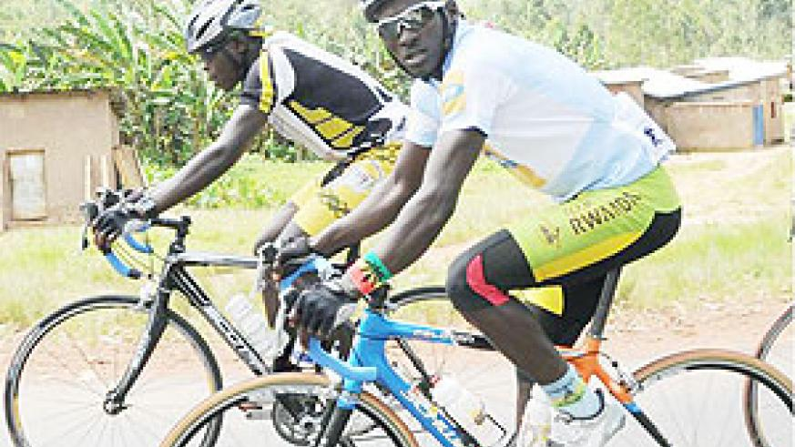 Abraham Ruhumuriza (R) will be one of Team Rwanda's riders in the five-day event.