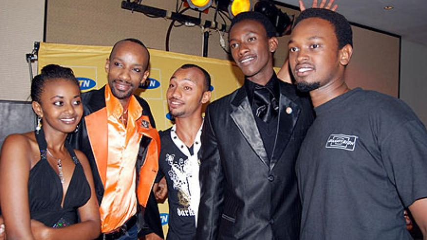 The winners pose with fashion designer, Daddy de Maximo, who dressed the contestants (second from left).