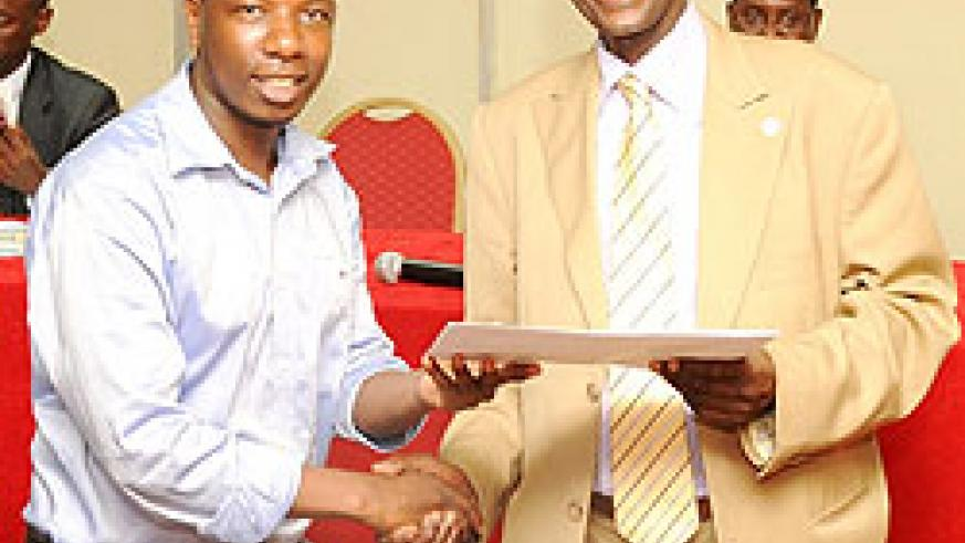 Prof. Geoffrey Rugege awarding a certificate to one of the students yesterday (photo T.Kisambira)