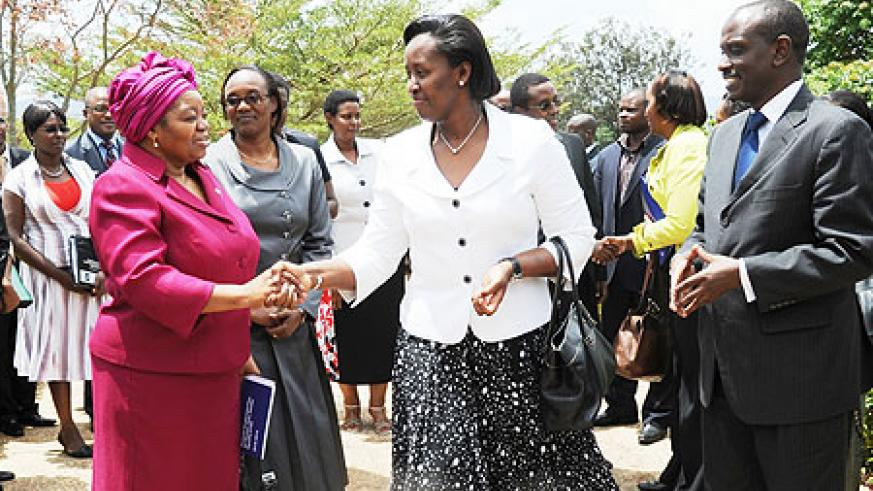 First Lady Jeannette Kagame greets Dr.Sheila Tlou (L), the Regional Director for UNAIDS-Eastern and Southern Africa as Health Minister Dr. Richard Sezibera looks on.(Photo J Mbanda)
