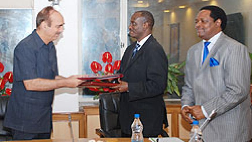 Health Minister Dr. Richard Sezibera and his Indian couter part Ghulam Nabi Azada after signing. Rwanda's envoy to India Williams Nkurunziza looks on. Courtesy photo