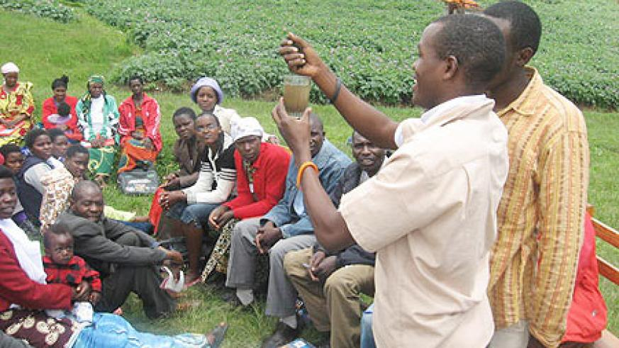 Hyppolite Ntigurirwa demonstrating to farmers during the theater training.