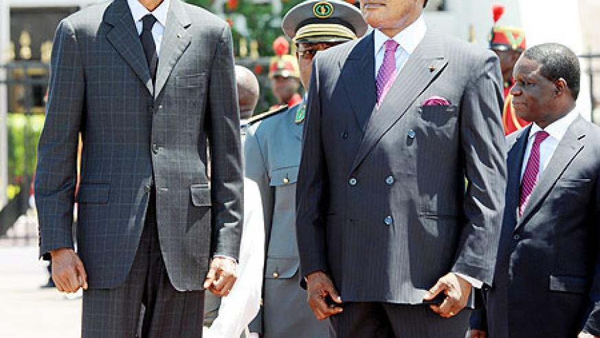 Front President Kagame with his Congolese counterpart, Sassou Nguesso. on arrival in Brazzaville Monday.