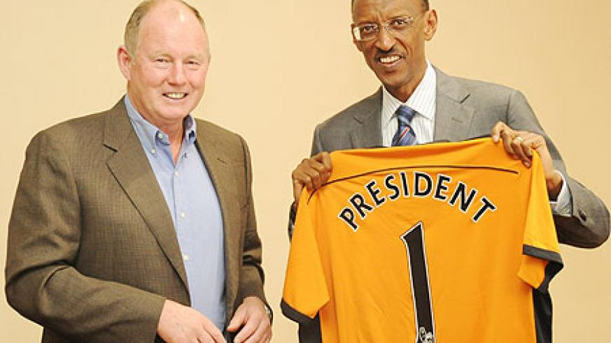 President Paul Kagame receives a Wolves jearsey from  Steve Morgan, the owner of Premier League Wolverhampton Wanderers yesterday (Photo; T. Kisambira)