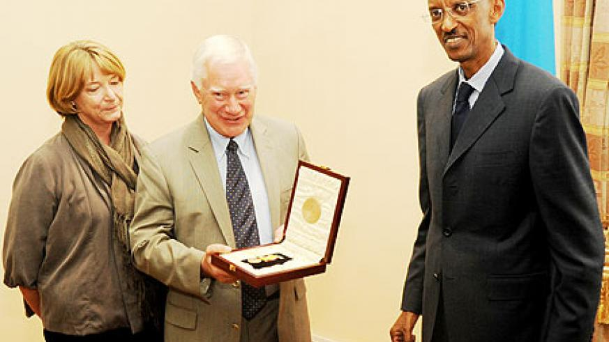 Amb Colin Keating with his wife after receiving the decoration from President Paul Kagame yesterday (Photo T.Kisambira)