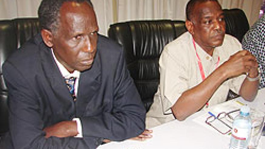 The dean of the faculty of agriculture at the NUR, Prof. Rukazambuga Ntirushwa (L), at the regional meeting in Kampala yesterday (Photo; G. Muramira)