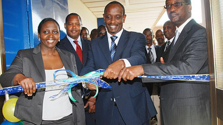 (L-R) Dr Juliet Mbabazi, the hospital's acting CEO, Dr Richard Sezibera, the Minister of Health, and James Gatera, the Managing Director, Bank of Kigali at the ceremony to unveil the MRI, last week. (Courtesy photo)