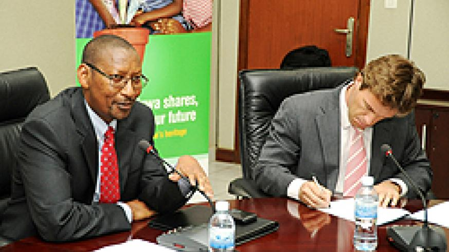 Minister John Rwangombwa and Sven-Erik Piederiet, Bralirwa's Managing Director during a press briefing a head of the IPO launch. (photo by Timothy Kisambira)