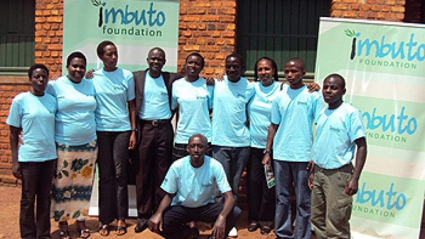 Some of the youth attending the Imbuto camp pose for a photo with officials, squatting is MP Francis Kaboneka (Photo P. Ntambara)