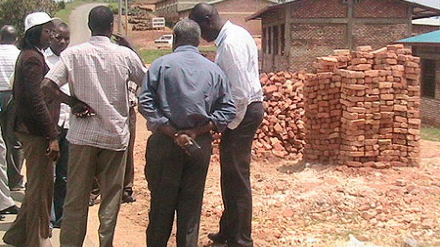 Minister Ruhamya and district leaders at one of the sites she visited (Photo; P. Ntambara)