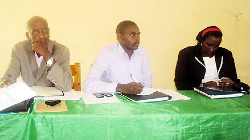 NEC's Frank Kayiranga (C) and local leaders during the meeting with the residents (Photo; S. Rwembeho)