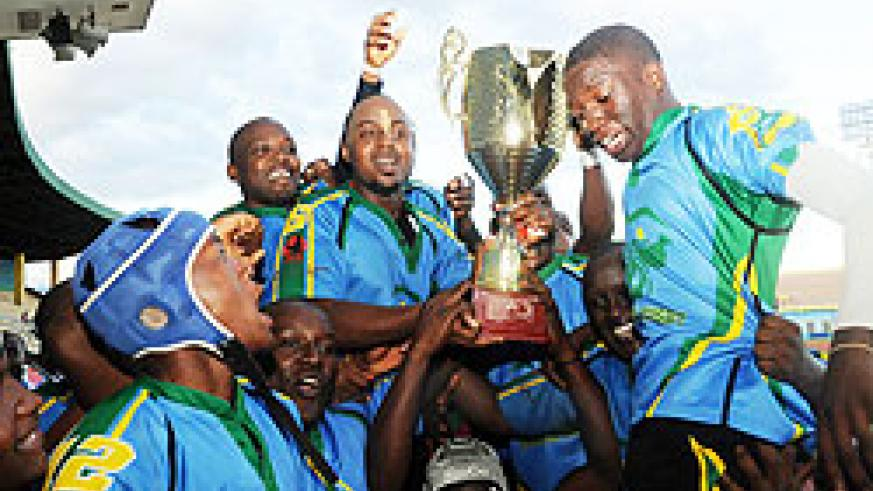 HAT-TRICK HEROES: Silverbacks players show off their third consecutive CAR 15s trophy at Amahoro Stadium. (Photo T. Kisambira)