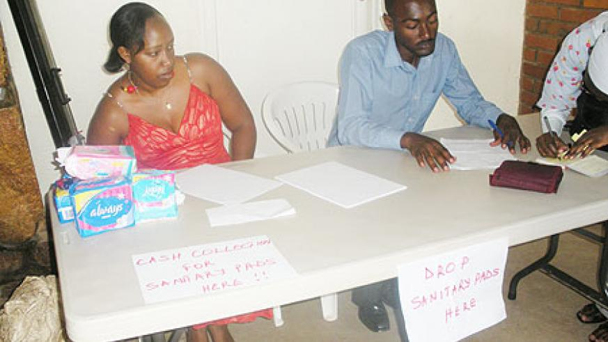 Sifa Uwera (L) and collegue collecting Sanitary Pads meant to benefit women suffering from obsteric fistula.