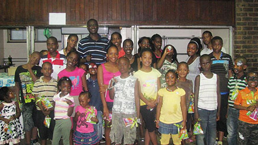 Envoy Ignatius Kamali in a group photo with Rwandan children living in South Africa (Courtesy Photo)