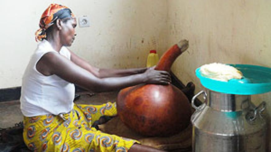Esperance Mukagatare makes butter traditionally. Photo S Rwembeho