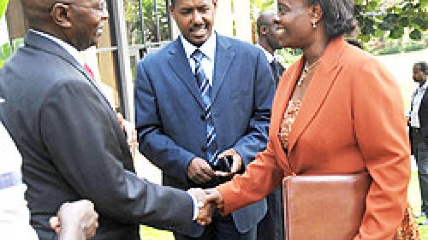 Permanent Secretary in the Ministry of Infrastructure Marie Claire Mukasine (R) greets Kenya Revenue Authority  Commissioner General, Michael Waweru as Eugene Torero looks on. (Photo J Mbanda)