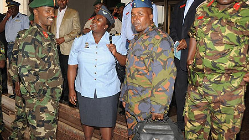 The Chief of Defence Staff Lt. Gen. Charles Kayonga (L) talking to the delegation from the Kenya National Defence College.