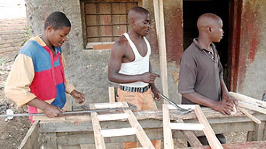 Youth at work in a Carpentry workshop. More youth will benefit from a new TVET programme  announced yesterday (File Photo)