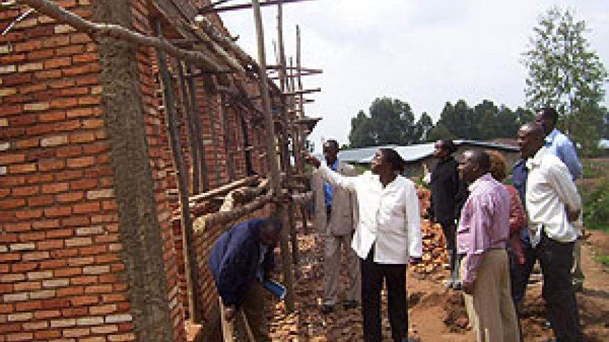 Minister Mujawamariya  inspects 9YBE class rooms at GS Kageyo on Wednesday. Photo A.Gahene