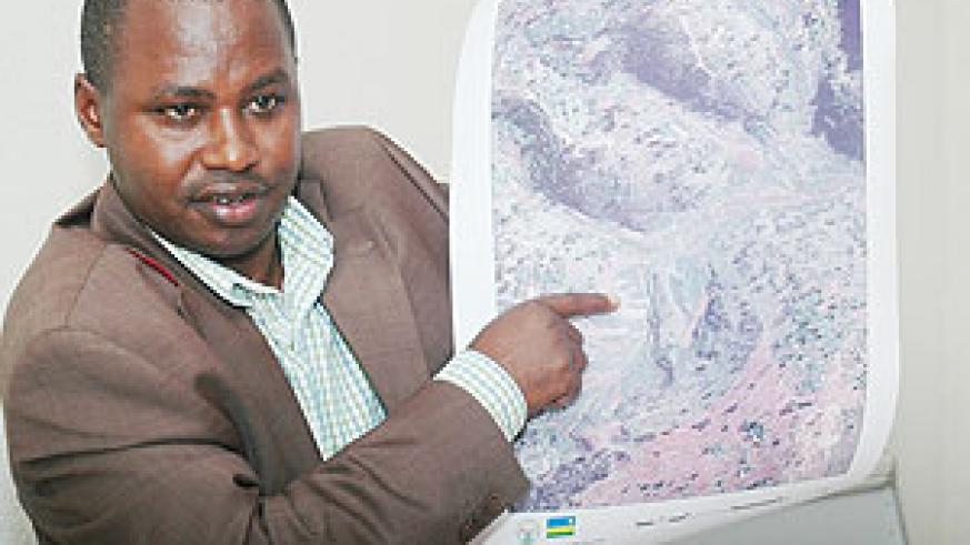 The Director General of Land Centre Dr Emmanuel Nkuruziza demonstrating how land mapping is done in a past event (File Photo)