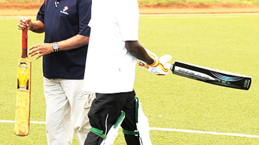 ICC's Cassim Suliman (left) and Sports minister Joseph Habineza (right) prepare for the ceremonial opening of the T20 game on Saturday. (Photo; T. Kisambira)