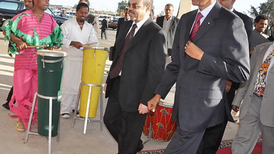 President Kagame arrives in Addis Ababa for the 5th International Conference on Federalism. He was welcomed by Ethiopian Prime Minister Meles Zenawi. (Photo/ Village Urugwiro)