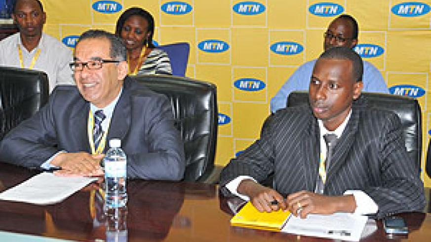 MTN's Chief Executive Officer, Khaled Mikkawi  and the company's Marketing Operations Manager, Robert Rwakabogo during a press conference at the company's head office yesterday(Photo by T Kisambira)