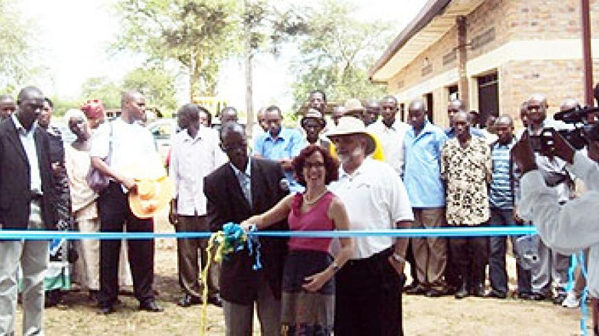 Anne Casper, US Embassy's deputy chief of mission cutting the ribbon to inaugurate water and can washing facilities in Nyagatare (Photo D ngabonziza)