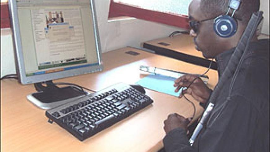 A visually impaired student uses a computer at the start of the training (Photo P Ntambara)