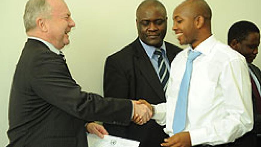 A chief trainer from Geneva giving a certificate to one of the participants.