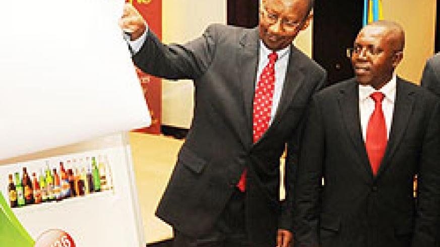 Minister of Finance John Rwangombwa unveils the Bralirwa IPO last month. He has described the IPO as a success (File Photo)