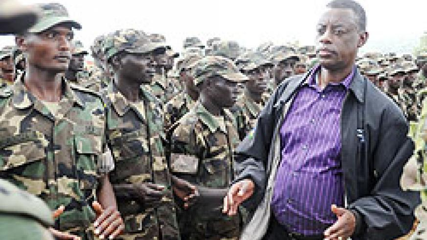 Defence Minister, James Kabarebe joins the Special Forces in a morale boosting session after their pass-out yesterday (Photo T Kisambira)