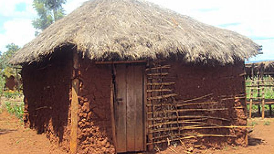 The type of houses to be replaced by permanent iron sheet- roofed ones across the country. (Photo by. S. Rwembeho).