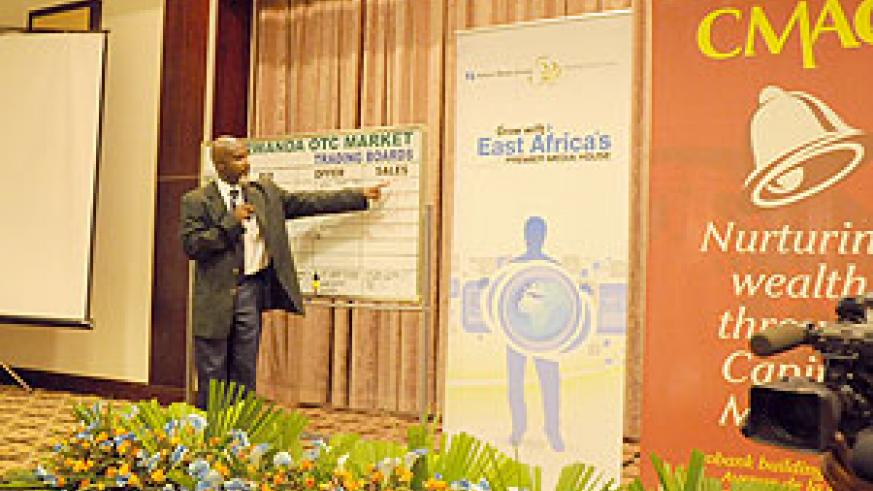 Celestine Rwabukumba, the Operations Manager of CMAC introducing NMG on the ROTC market last month (file photo)