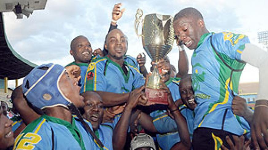 Silverbacks' players show off their CAR15s trophy after seeing off Burundi in the final early this month. (File Photo)