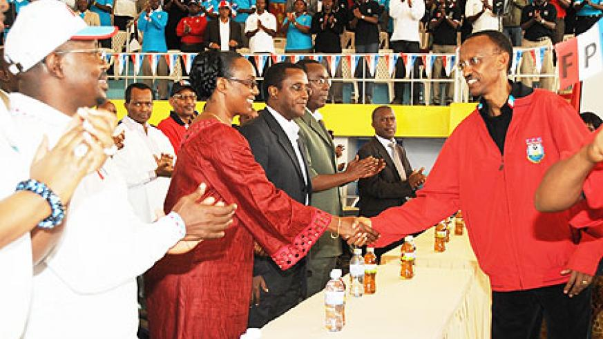 President Paul Kagame greets delegates upon arrival at the 10th RPF Congress, yesterday. (Photo J Mbanda)