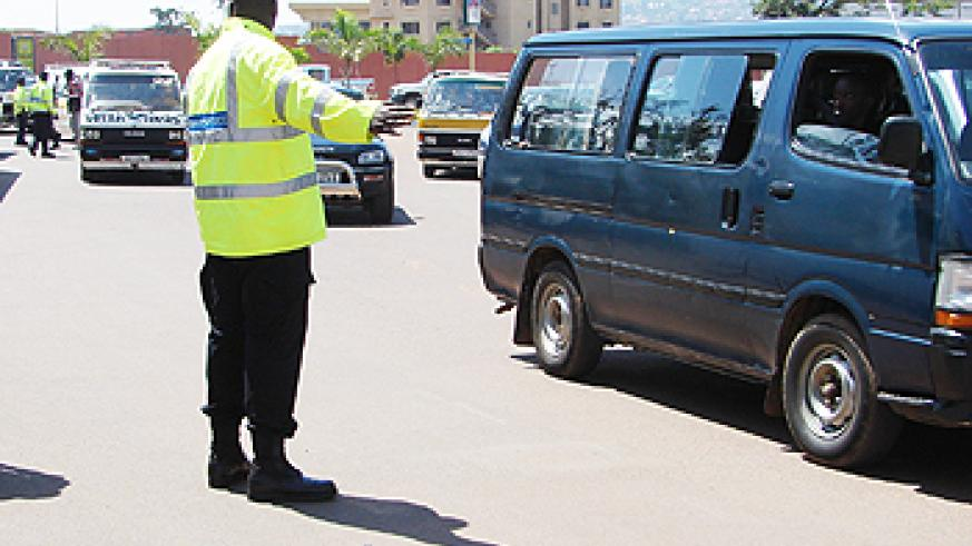 A Traffic Police officer on duty in a Kigali Street. Police has concluded training of officers on road safety (File Photo)