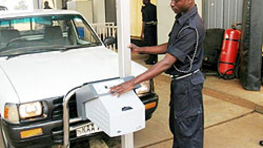 A Policeman checks a vehicle at the Technical control centre in Remera.